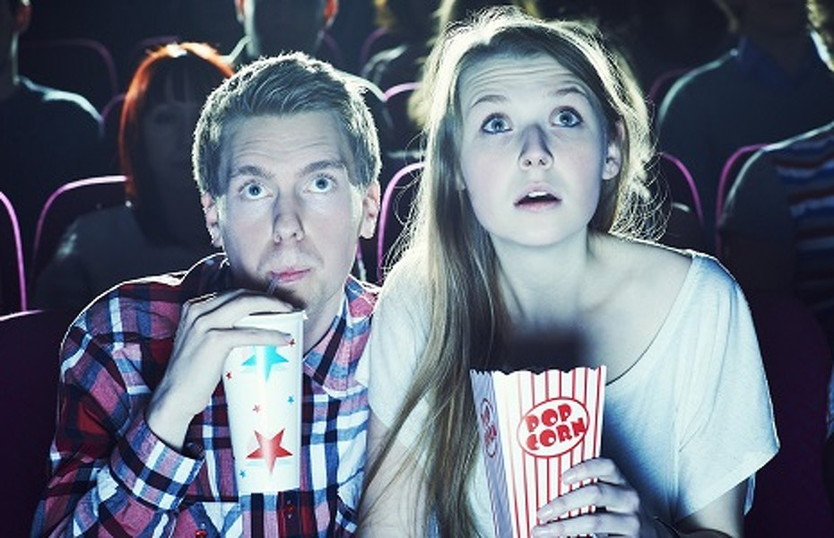 couple enjoying a movie at the cinema   (c) Brand New Images